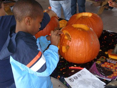 boy_carving_pumpkin.jpg