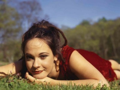 girl laying down on grass.png